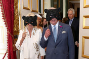Camilla, Duchess of Cornwall and Prince Charles, Prince of Wales hold masks over their faces as they host a reception for the Elephant Family Animal Ball at Clarence House on June 13, 2019 in London, England. Elephant Family is an international NGO dedicated to protecting the Asian elephant from extinction in the wild.