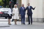 Claudia Mueller, Camilla, Duchess of Cornwall, Prince Charles, Prince of Wales and Berlin Mayor Michael Mueller walk under the Brandenburg Gate on May 7, 2019 in Berlin, Germany. Their Royal Highnesses are paying an official visit to Germany at the request of the British government. The four-day-trip from May 7-10  will include visits to Berlin, Leipzig and Munich.