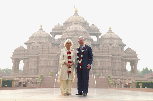 Camilla, Duchess of Cornwall and Prince Charles, Prince of Wales pose outside the Akshardham Temple during day 3 of an official visit to India on November 8, 2013 in Delhi, India. This will be the Royal couple's third official visit to India together and their most extensive yet, which will see them spending nine days in India and afterwards visiting Sri Lanka in order to attend the 2013 Commonwealth Heads of Government Meeting.