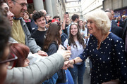 Camilla, Duchess Of Cornwall (R) meets wellwishers during a visit to the Vasari Corridor on day three of her tour of Italy on April 2, 2017 in Florence, Italy.  Designed by Giorgio Vasari and built by Grand Duke Cosimo I de'Medici in 1565, the Vasari Corridor connects the gallery of statues and paintings in the Uffizi Gallery to Palazzo Pitti and was built to allow the Grand Dukes of Florence to move safely from their private residence at Palazzo Pitti to the government's headquarters at Palazzo Vecchio.