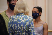 Camilla, Duchess of Cornwall speaks with Royal Ballet dancer Francesca Hayward, during a reception held after a performance by The Royal Ballet to celebrate the return of the arts and entertainment, post lockdown at the Royal Opera House on June 10, 2021 in London, England.