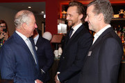 Prince Charles, Prince of Wales (L) and Tom Hiddleston (C) during an official visit to BFI Southbank on December 06, 2018 in London, England.  The Prince of Wales has been Patron of the British Film Institute for 40 years.