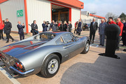 Prince Charles, Prince of Wales inspects a Ferrari Dino during a vist to the Pirelli tyre factory on April 8, 2019 in Carlisle, England. The Prince paid a visit to the factory to help staff celebrate fifty years of tyre making in Carlisle.