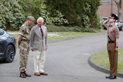 Prince Charles, Prince of Wales is received by Commanding Officer, Lieutenant Colonel Henry Llewelyn-Usher as he arrives to visit members of the Welsh Guards at Combermere Barracks on May 5, 2021 in Windsor, England.