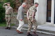 Prince Charles, Prince of Wales walks with Commanding Officer, Lieutenant Colonel Henry Llewelyn-Usher to the Officers' Mess as he arrives to visit members of the Welsh Guards at Combermere Barracks on May 5, 2021 in Windsor, England.