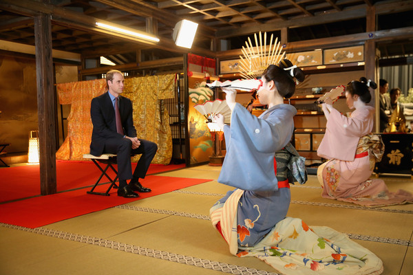 Prince William Prince William, Duke of Cambridge watches a performance by acresses in Geisha costumes during a visit to the set of a historical drama at NHK Public Broadcasting Studios during the third day of his visit to Japan on February 28, 2015 in Tokyo, Japan. The Duke of Cambridge is visiting Japan from February 26th to March 1st 2015.