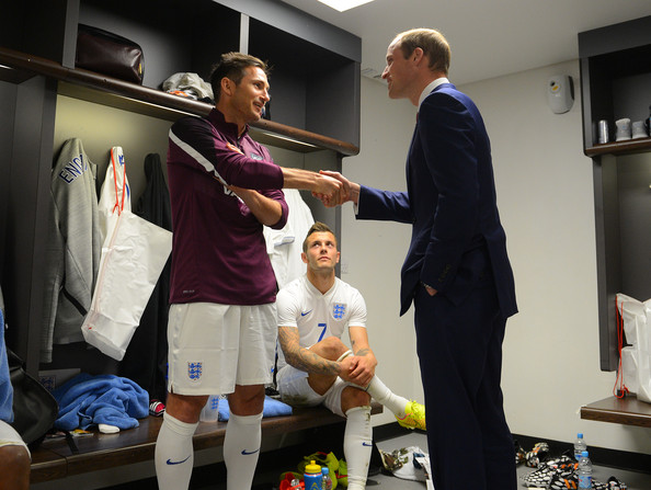 Prince William 30 GMT) In this handout image provided by The FA, President of the Football Association Prince William, Duke of Cambridge speaks to England players Frank Lampard and Jack Wilshere after the International Friendly match between England and Peru at Wembley Stadium on May 30, 2014 in London, England.