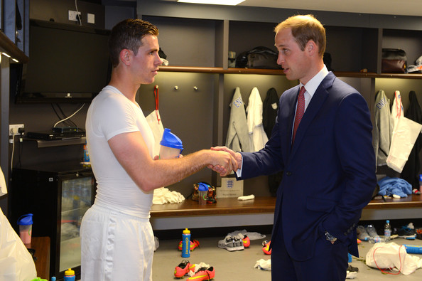 Prince William 30 GMT) In this handout image provided by The FA,  President of the Football Association Prince William, Duke of Cambridge speaks to England player Jordan Henderson in the team changing room after the International Friendly match between England and Peru at Wembley Stadium on May 30, 2014 in London, England.