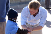 Prince Harry meets HIV affected children at the Mamahato Network Club at King Letsie's Palace on June 17, 2010 in Maseru, Lesotho. The two Princes are on a joint trip to Africa which takes in Botswana, Lesotho and finally South Africa. During that time they will visit a number of projects supported by their respective charities Sentebale (Prince Harry) and Tusk Trust (Prince William). The trip will culminate with the brothers watching the England vs Algeria World Cup match in Cape Town.