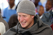 Prince Harry holds a young boy during a visit to a child education centre on June 17, 2010 in Semonkong, Lesotho. The two Princes are on a joint trip to Africa which takes in Botswana, Lesotho and finally South Africa. During that time they will visit a number of projects supported by their respective charities Sentebale (Prince Harry) and Tusk Trust (Prince William). The trip will culminate with the brothers watching the England vs Algeria World Cup match in Cape Town.