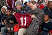 Prince Harry and Prince William are presented with football shirts during a visit to a child education centre on June 17, 2010 in Semonkong, Lesotho. The two Princes are on a joint trip to Africa which takes in Botswana, Lesotho and finally South Africa. During that time they will visit a number of projects supported by their respective charities Sentebale (Prince Harry) and Tusk Trust (Prince William). The trip will culminate with the brothers watching the England vs Algeria World Cup match in Cape Town.
