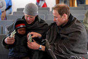 Prince Harry and Prince William put gloves on a young boy during a visit to a child education centre on June 16, 2010 in Semonkong, Lesotho. The two Princes are on a joint trip to Africa which takes in Botswana, Lesotho and finally South Africa. During that time they will visit a number of projects supported by their respective charities Sentebale (Prince Harry) and Tusk Trust (Prince William). The trip will culminate with the brothers watching the England vs Algeria World Cup match in Cape Town.