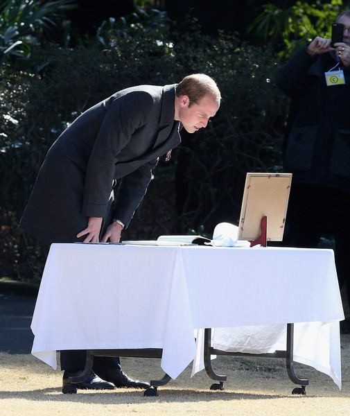 Prince William Prince William, Duke of Cambridge looks at a photograph of his late mother Princess Diana as he visits Hodogaya Commonwealth War Graves Cemetery on the second day of his visit to Japan on February 26, 2015 in Yokohama, Japan. The Duke of Cambridge is visiting Japan from February 26th to March 1st 2015.