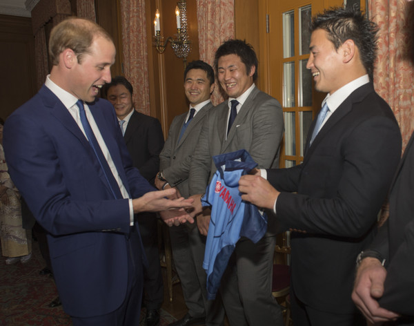 Prince William Members of the Japans Rugby World Cup Squad  meet Prince William, Duke of Cambridge and present him with a shirt for Prince George at a reception at the British Embassy, given by the Ambassador, where he met high profile Japanese figures including politicians, artists, young leaders, sportsmen and other leaders in their field on February 27, 2015 in Tokyo, Japan. The Duke of Cambridge is visiting Japan from February 26th to March 1st 2015.