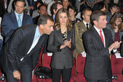 Prince Felipe of Spain (L) and Princess Letizia of Spain (R) and United States Ambassador to France and Monaco Charles H. Rivkin (R) attend a minute of silence during the launch of the 7th International Congress for the Victims of Terrorism at Ecole Militaire on September 15, 2011 in Paris, France.