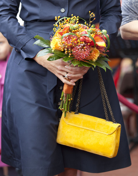 Princess Maxima Princess Maxima of The Netherlands (bag and flowers detail) opens the domestic violence 'Oranje Huis' womens' shelter on August 30, 2011 in Alkmaar, Netherlands.