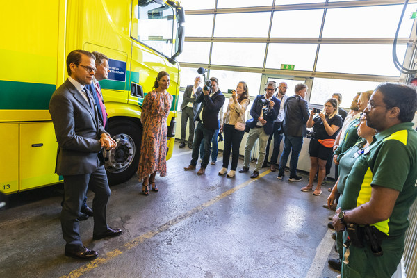 Swedish Royals Visit The Ambulance Service In The Stockholm Region [yellow,transport,community,personal protective equipment,event,vehicle,team,plant,city,crowd,royals,victoria,daniel,crowd,ambulance service,yellow,stockholm region,swedish,ambulance station,suburb,car,recreation,crowd]