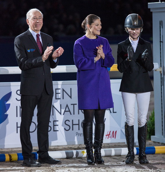 Crown Princess Victoria of Sweden (M) and Malin Baryard-Johnsson (R) attends Sweden International Horse Show 2014 at Friends Arena on November 28, 2014 in Stockholm, Sweden.