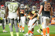 Team Irvin tight end Jimmy Graham #80 of the New Orleans Saints is hit in the end zone after scoring a touchdown in the second half of the 2015 Pro Bowl at University of Phoenix Stadium on January 25, 2015 in Glendale, Arizona.