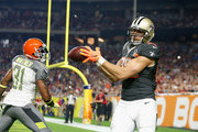 Team Irvin tight end Jimmy Graham #80 of the New Orleans Saints hauls in a pass over Team Carter safety Donte Whitner #31 of the Cleveland Browns during the first half of the 2015 Pro Bowl at University of Phoenix Stadium on January 25, 2015 in Glendale, Arizona.
