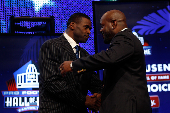 Emmitt Smith (R) is congratulated by former teammate Michael Irvin after Smith was announced as one of the newest enhrinees into the Hall of Fame during the Pro Football Hall of Fame Class of 2010 Press Conference held at the Greater Ft. Lauderdale/Broward County Convention Center as part of media week for Super Bowl XLIV on February 6, 2010 in Fort Lauderdale, Florida.