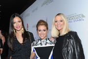 (L-R) Georgina Chapman, Alyssa Milano and Zanna Roberts Rassi attend the Project Runway All Stars Season 3 premiere party presented by The Weinstein Company and Lifetime in partnership with Marie Claire, QVC, Mary Kay and Alterna Haircare at Hudson Common at the Hudson Hotel on October 22, 2013 in New York City.