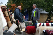 Green Party prospective parliamentary candidate, Larry Sanders (R), who is the brother of former U.S Democrat presidential nominee Bernie Sanders, chats with a market trader as he canvasses ahead of the Witney by-election on October 13, 2016 in Witney, England. The seat was vacated by former Prime Minister David Cameron when he stepped down as an MP in September this year, and campaigning has begun by all parties for the now-vacant seat with the by-election due to take place on October 20.