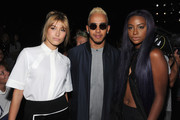 (L-R) Model Hailey Baldwin, Formula One driver Lewis Hamilton and singer Justine Skye attend Public School Spring 2016 during New York Fashion Week: The Shows  at The Arc, Skylight at Moynihan Station on September 13, 2015 in New York City.