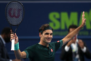 Roger Federer of Switzerland celebrates winning his match against Dan Evans of Great Britain on Day 3 of the Qatar ExxonMobil Open at Khalifa International Tennis and Squash Complex on March 10, 2021 in Doha, Qatar.