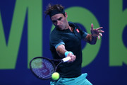 Roger Federer of Switzerland returns a forehand in his match against Dan Evans of Great Britain on Day 3 of the Qatar ExxonMobil Open at Khalifa International Tennis and Squash Complex on March 10, 2021 in Doha, Qatar.