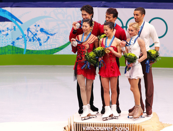 Vancouver 2010 Winter Olympics at the UBC Thunderbird Arena [recreation,championship,competition event,competition,skating,sports,technology,individual sports,event,world,figure skating,l-r,silver medal,gold medal,bronze medal,china,jian tong,qing pang,robin szolkowy,aliona savchenko]