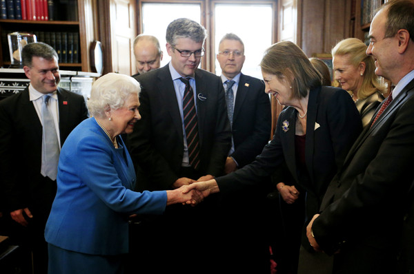 Queen Elizabeth II (C) stands by Royal Librarian Oliver Urquhart Irvine (C) as she greets Baroness Blackstone, Chair of the British Library, (R) while attending the launch of the George III Project at an event held in the Royal Library in Windsor Castle on April 1, 2015 in Windsor, England.