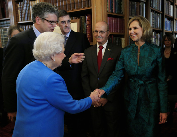 Queen Elizabeth II greets Lynn Forney Young, President of the Daughters of the American Revolution, (R) while attending the launch of the George III Project at an event held in the Royal Library in Windsor Castle on April 1, 2015 in Windsor, England.