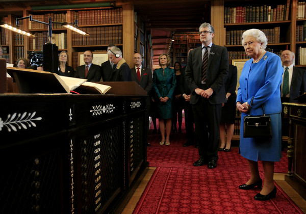 Queen Elizabeth II stands by Royal Librarian Oliver Urquhart Irvine (L) while attending the launch of the George III Project at an event held in the Royal Library in Windsor Castle on April 1, 2015 in Windsor, England.
