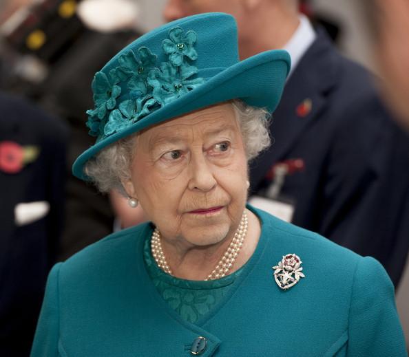 Queen Elizabeth II during an official visit to International Security Printers to view their work on specialist postage stamps on October 30, 2014 in Wolverhampton, England.
