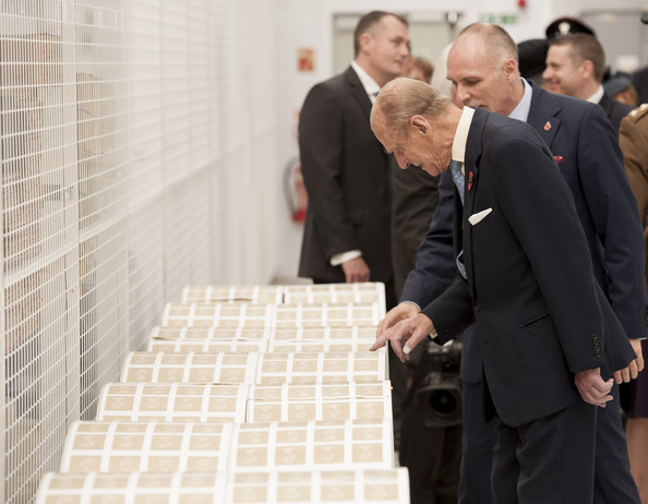 Prince Philip, Duke of Edinburgh examines large rolls of stamps during an official visit to International Security Printers to view their work on specialist postage stamps on October 30, 2014 in Wolverhampton, England.