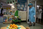 Britain's Queen Elizabeth II explores the classrooms at Mayflower Primary School during a visit to Poplar in Tower Hamlets in East London on June 15, 2017, as part of commemorations to mark the centenary of the bombing of Upper North Street School during the First World War..Mayflower Primary School now exists on the site of the Upper North Street School. / AFP PHOTO / POOL / Daniel LEAL-OLIVAS