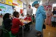 Britain's Queen Elizabeth II speaks with school children in a classroom at Mayflower Primary School during a visit to Poplar in Tower Hamlets in East London on June 15, 2017, as part of commemorations to mark the centenary of the bombing of Upper North Street School during the First World War..Mayflower Primary School now exists on the site of the Upper North Street School. / AFP PHOTO / POOL / Daniel LEAL-OLIVAS