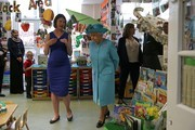 Britain's Queen Elizabeth II (centre right) is shown around a classroom at Mayflower Primary School during a visit to Poplar in Tower Hamlets in East London on June 15, 2017, as part of commemorations to mark the centenary of the bombing of Upper North Street School during the First World War..Mayflower Primary School now exists on the site of the Upper North Street School. / AFP PHOTO / POOL / Daniel LEAL-OLIVAS