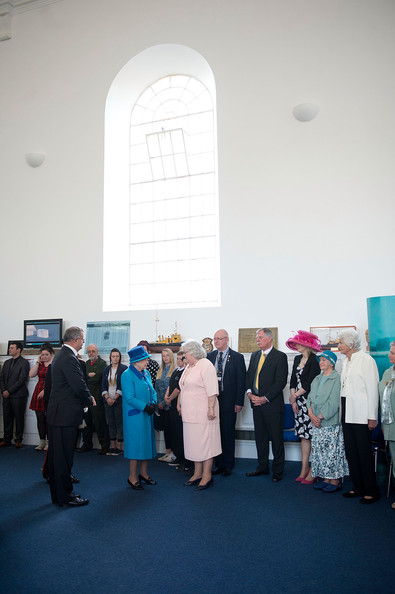 Queen Elizabeth II visits the Chapel to view the restoration and meet local people involved with the project at the Royal Dockyard Chapel during an official visit on April 29, 2014 in Pembroke Dock, United Kingdom. This year sees the 200th anniversary of the town of Pembroke Dock. The Royal Dockyard Chapel has undergone a restoration project to become the base for Pembroke Dock's Heritage Centre which celebrates 200 years of a unique naval and military community.