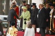 Queen Elizabeth II greets Colombia's President Juan Manuel Santos as Prince Philip looks on at a ceremonial welcome for Colombia's President Juan Manuel Santos and his wife Maria Clemencia de Santos at Horse Guards Parade on November 1, 2016 in London, England. The President is on a state visit to Britain.