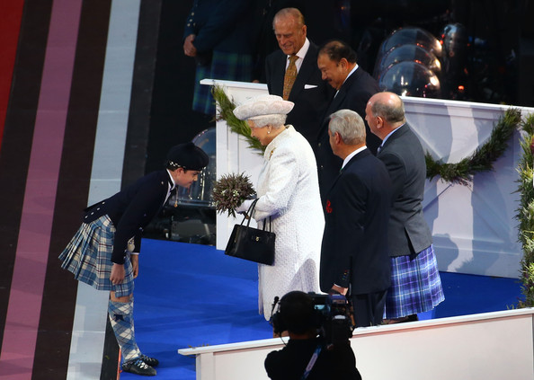 Queen Elizabeth II Connor Woodcock presents Queen Elizabeth II with a posy of heather during the Opening Ceremony for the Glasgow 2014 Commonwealth Games at Celtic Park on July 23, 2014 in Glasgow, Scotland.