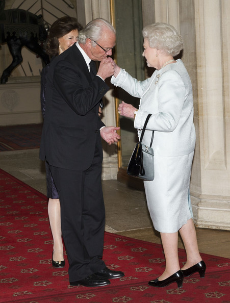 Queen Elizabeth II greets King Carl XVI Gustaf of Sweden and Queen Silvia of Sweden as they arrive at a lunch for Sovereign Monarch's held in honour of Queen Elizabeth II's Diamond Jubilee, at Windsor Castle, on May 18, 2012 in Windsor, England.