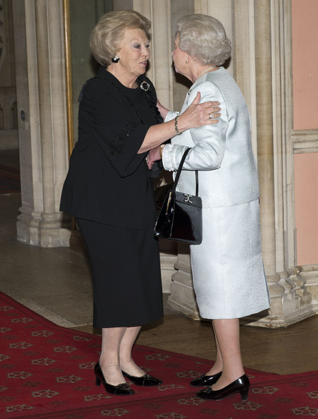 Queen Elizabeth II greets Queen Beatrix of Holland as she arrives at a lunch for Sovereign Monarch's held in honour of Queen Elizabeth II's Diamond Jubilee, at Windsor Castle, on May 18, 2012 in Windsor, England.