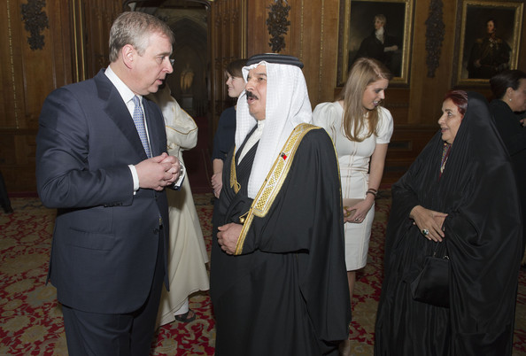 Prince Andrew, Duke of York speaks with The King of Bahrain Hamad bin Isa Al Khalifa as Princess Beatrice speaks with Princess Sabeeka of Bahrain during a reception in the Waterloo Chamber, before the Lunch For Sovereign Monarchs at Windsor Castle, on May 18, 2012 in Windsor, England.