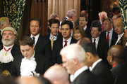Members of Parliament including British Prime Minister David Cameron,  Deputy Prime Minister and leader of the Liberal Democrats Nick Clegg and Leader of the Labour Party Ed Miliband walk through the Members' Lobby before the Queen's Speech at the State Opening of Parliament  on June 4, 2014 in London, England. Queen Elizabeth II unveiled the coalition government's legislative programme in a speech delivered to Members of Parliament and Peers in The House of Lords. Proposed legislation is expected to be introduced on a 5p charge for plastic bags in England, funding of workplace pensions, new state-funded childcare subsidy and reforms to speed up infrastructure projects.