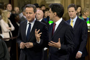 British Prime Minister David Cameron (L)  Deputy Prime Minister and leader of the Liberal Democrats Nick Clegg (R) Leader of the Labour Party Ed Miliband (C) walk through the Members' Lobby before the Queen's Speech at the State Opening of Parliament  on June 4, 2014 in London, England. Queen Elizabeth II will unveil the coalition government's legislative programme in a speech delivered to Members of Parliament and Peers in The House of Lords. Proposed legislation is expected to be introduced on a 5p charge for plastic bags in England, funding of workplace pensions, new state-funded childcare subsidy and reforms to speed up infrastructure projects.