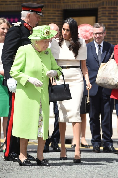 The Duchess Of Sussex Undertakes Her First Official Engagement With Queen Elizabeth II [duchess of sussex undertakes her first official engagement with,fashion,event,street fashion,headgear,outerwear,uniform,ceremony,gesture,hat,elizabeth ii,meghan markle,harry,pair,chester town hall,sussex,the storyhouse,road bridge,the duchess]