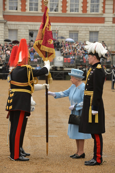 Queen Elizabeth II presents the Household Cavalry with new standards at Horse Guards Parade, on May 28, 2014 in London, Untied Kingdom.
