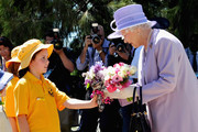 Queen Elizabeth II receives flowers from 9 year old Jessica Brewer during a visit to Floriade Flower Festival on October 20, 2011 in Canberra, Australia. The Queen and Duke of Edinburgh are on a 10-day visit to Australia and will travel to Canberra, Brisbane, and Melbourne before heading to Perth for the Commonwealth Heads of Government meeting. This is the Queen's 16th official visit to Australia.